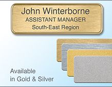 75x25mm gilt/chrome badge 3 lines of text